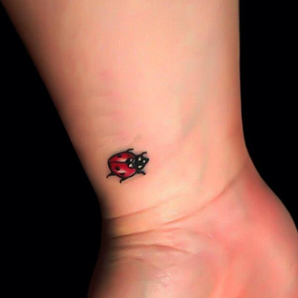 Small beetle tattoo designs are very suitable placed on the wrist, because it would be easy to hide with a watch that we wear. This design is very cute to wear a girl who is afraid to show off her tattoo.