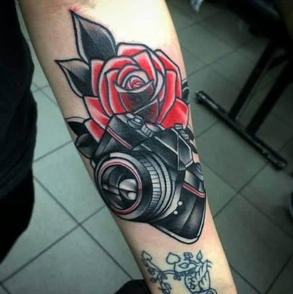 41b2f6a46dc61 A great tattoo design that has a camera with a gorgeous red rose behind it.  How could you not love such a beautiful tattoo? It's a classic style that  is ...