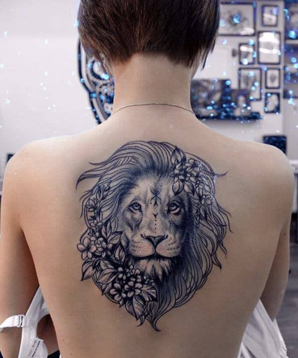 68d5dab41c625 A great tattoo design that has a fierce lion with some great flowers with  it.