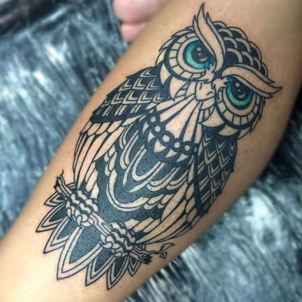 48436525cbee8 Another blue eyed beauty on a simple, black ink owl tattoo.
