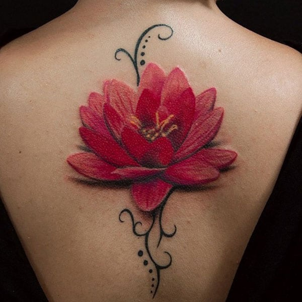 155 trendy lotus flower tattoos that you dont want to miss and it certainly looks wonderful on a lotus flower the 3d effect makes it look like its real and alive kodus to this designs tattoo artist mightylinksfo
