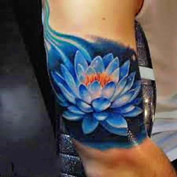 8d53fd3a67a03 This is another blue color of a lotus flower tattoo. People love this color  as it signifies the oceans. Since the lotus flower is an aquatic plant, ...