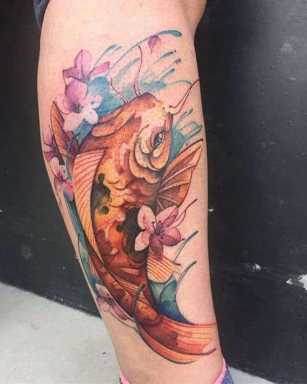60c2243b8 Colourful koi fish tattoos are quite charming to look at as the colours  outline each of the features beautifully. The colourful flowers used in the  design ...