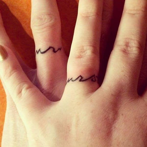 fa7b96445 225+ Wedding Ring Tattoos for 2019